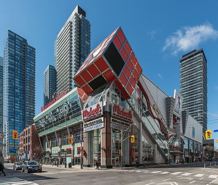 This image is a photograph of the exterior of the Scotiabank Theatre taken during the daytime.