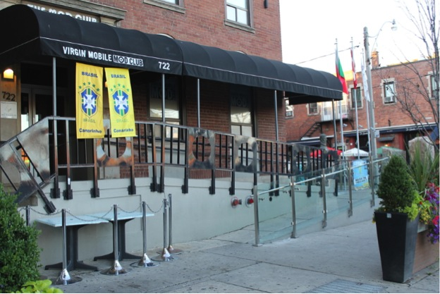 This image is of a photograph that shows the front entrance of the Mod Club, with a ramp to the right.