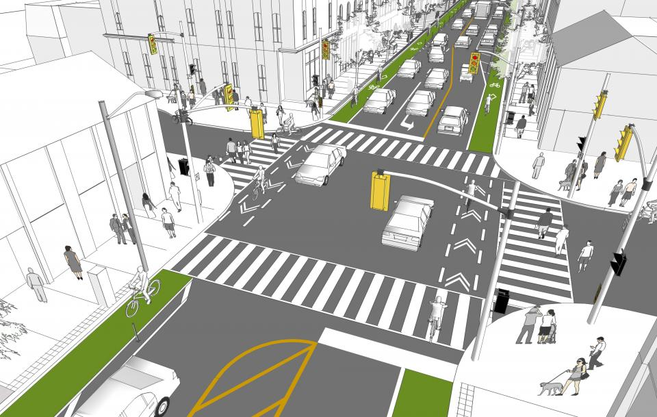 A drawing of a road intersection with bike lanes and pedestrian cross lines